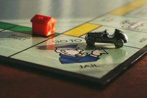 Cheap bail bonds shown on Monopoly board.