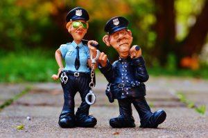 law enforcement toys on the sidewalk