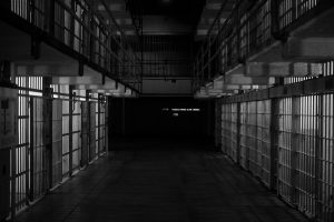 The inside of a dark black and white jail