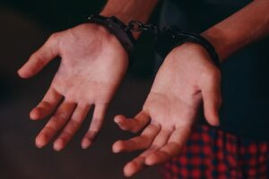 a person handcuffed